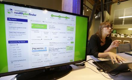 Nelly Kinsella demonstrates the Washington Healthplanfinder website, where consumers will be able to shop for health insurance, following a news conference Monday, Sept. 30, 2013, in Seattle.
