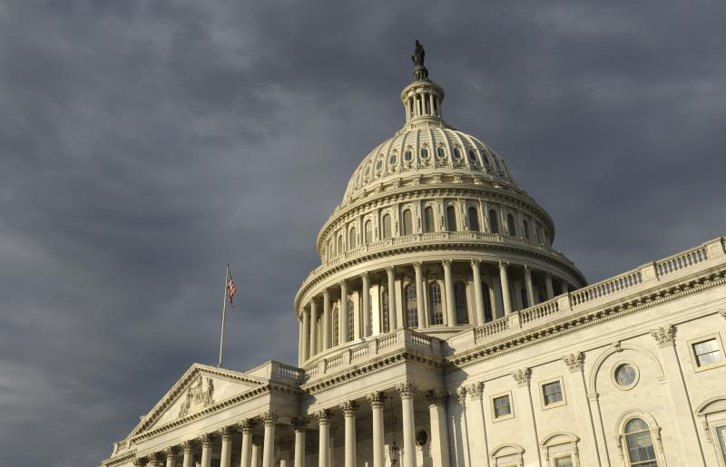 Dark clouds pass over the Capitol in Washington, Tuesday, Oct. 1, 2013.