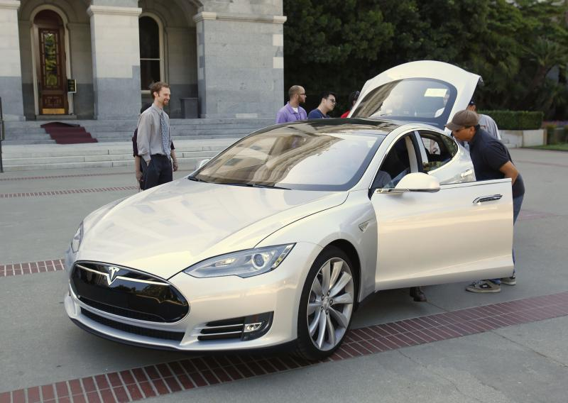 File: Visitors to the Capitol had the opportunity to inspect the Tesla Motors Model S electric sedan on display in Sacramento, Calif., Tuesday June 18, 2013.