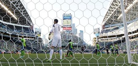 Sounders goalkeeper Michael Gspurning, center, calls to teammates to position his defense during a match against D.C. United on July 3, 2013, at CenturyLink Field in Seattle.