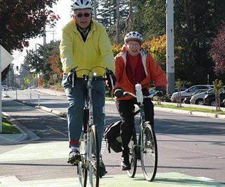 Riders on Linden Ave. cycle track in North Seattle are separated from traffic.