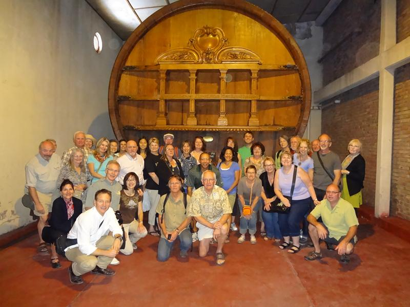 The Travel Club is dwarfed by a massive wine cask at Bodega Weinert.