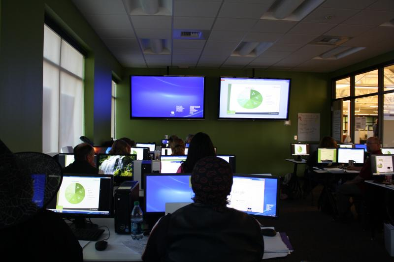 New hires train to take calls at Washington's health exchange call center in Spokane Valley.