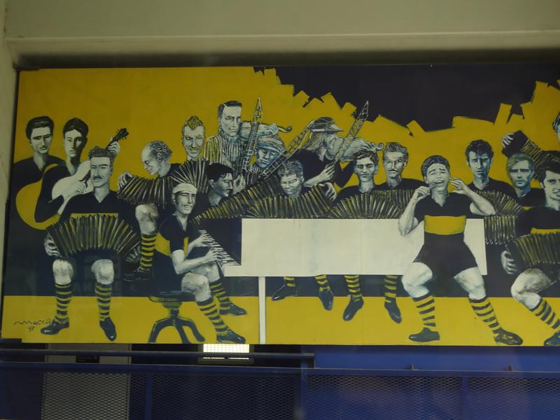 A mural at the BOCA Juniors soccer stadium shows the legendary Diego Maradona as a tango singer.