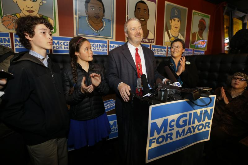 Seattle Mayor Mike McGinn, center, stands with his family as he talks to supporters on election night.