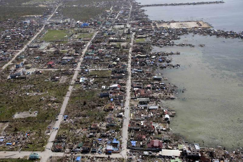 An aerial image taken from a Philippine Air Force helicopter shows the devastation causedl by typhoon Haiyan in Guiuan, Eastern Samar province, central Philippines Monday, Nov. 11, 2013.