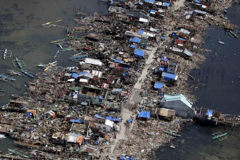 An aerial image taken from a Philippine Air Force helicopter shows the devastation of the first landfall by typhoon Haiyan in Guiuan, Eastern Samar province, central Philippines Monday, Nov. 11, 2013.
