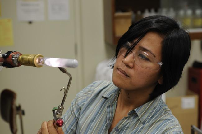 Researcher Marianne Tarun seals an ampoule containing a unique crystal.