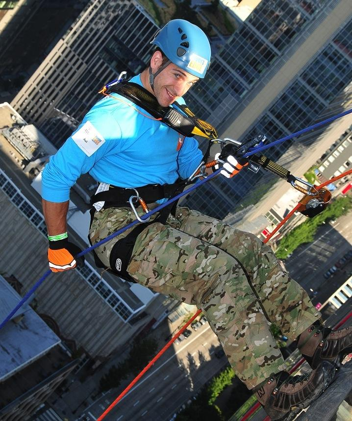 "Avi Jacobson rappels off a building in 2012 for the ""Over the Edge"" benefit at the Washington State Housing Finance Commission."