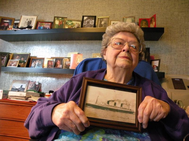 Norma Strecker with a picture of the Ile de France, the ship that took her across the Atlantic to the European Theater of World War II.