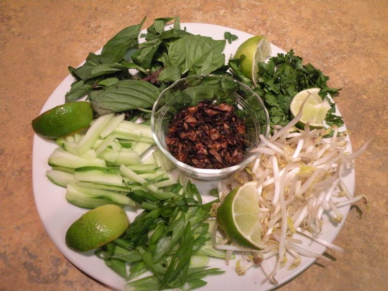 Laksa garnishes. Clockwise from top: Thai basil, cilantro, bean sprouts, green onions, julienned cukes.  In center: fried shallots.