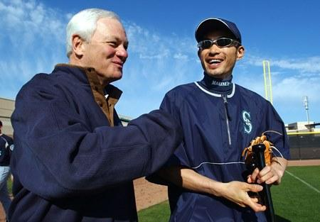 Mariners' outfielder Ichiro Suzuki is greeted by team president Chuck Armstrong on the first day of full squad workouts in February 2004, at the team's spring training facility in Peoria, Ariz.