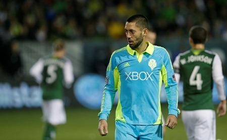 Game and season over. The Sounders' Clint Dempsey walks off the pitch after the Sounders lost to the Portland Timbers 3-2 Thursday night in Portland, in the second game of the Western Conference semifinals in the MLS Cup soccer playoffs.