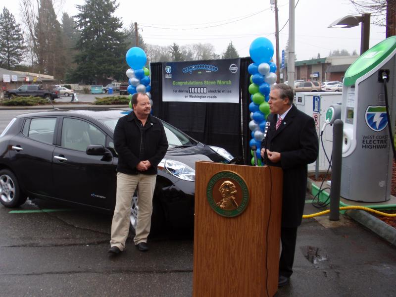 Commuter Steve Marsh, left, of Kent, Wash. was honored Monday as the first in the nation to log 100,000 miles on an all-electric Nissan Leaf.
