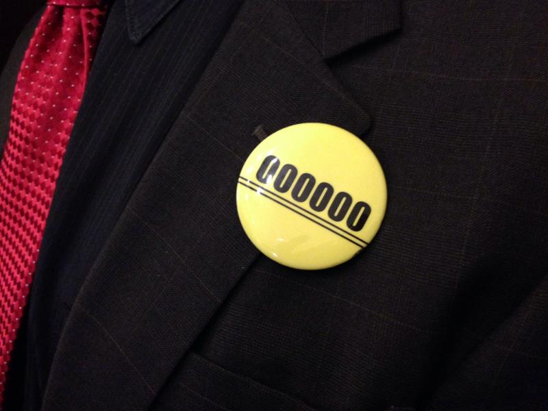 Members of the Washington Education Association wore these buttons to the governor's supplemental budget rollout to signify five years without voter-approved cost-of-living increases.