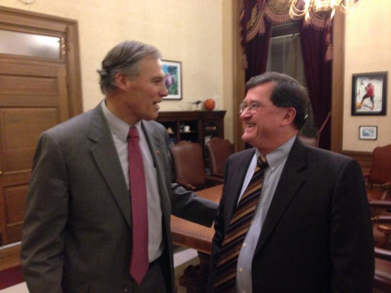 Gov. Jay Inslee has a light moment with transportation co-chair Senator Curtis King, R-Yakima after announcing there is no deal on a gas tax package.