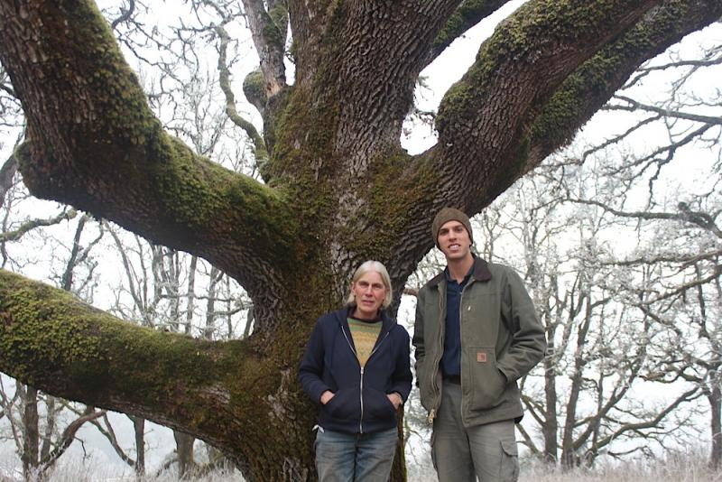 Sarah and Ben Deumling stand beneath one of the many oak trees on their 1,300 acre property northwest of Salem, Oregon.
