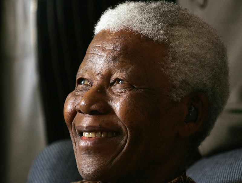 Former South African President Nelson Mandela smiles during his meeting with a group of Mandela Rhodes Scholars for 2006, in Johannesburg, South Africa, Tuesday, Jan. 31, 2006.