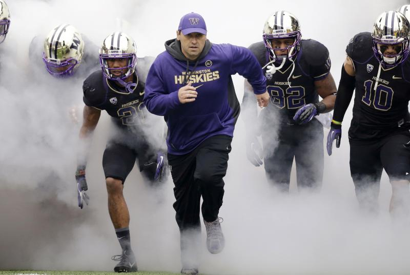 FILE - In this Nov. 29, 2013 file photo, Washington head coach Steve Sarkisian runs onto the field before NCAA college football game against Washington state in Seattle.
