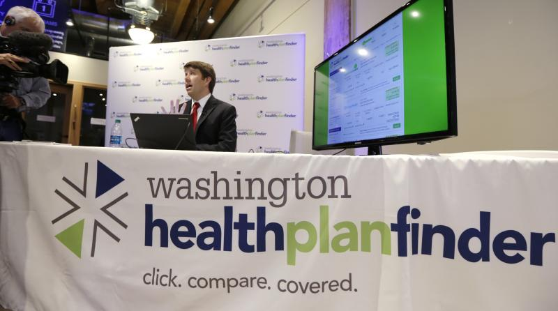 FILE - Brad Finnegan demonstrates the Washington Healthplanfinder website, where consumers will be able to shop for health insurance, following a news conference Monday, Sept. 30, 2013, in Seattle.