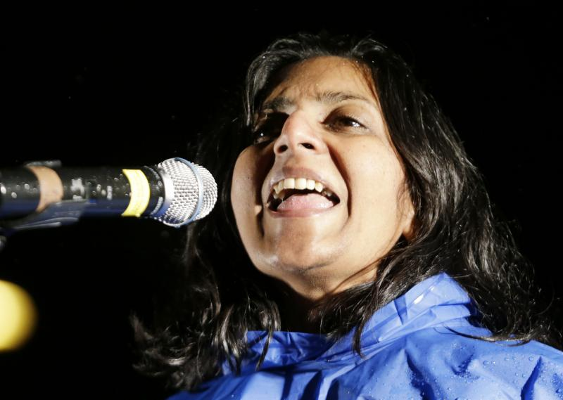 "FILE - Kshama Sawant, a socialist newly-elected to the Seattle city council, speaks at a ""Build it Here"" rally Monday, Nov. 18, 2013, in downtown Seattle."