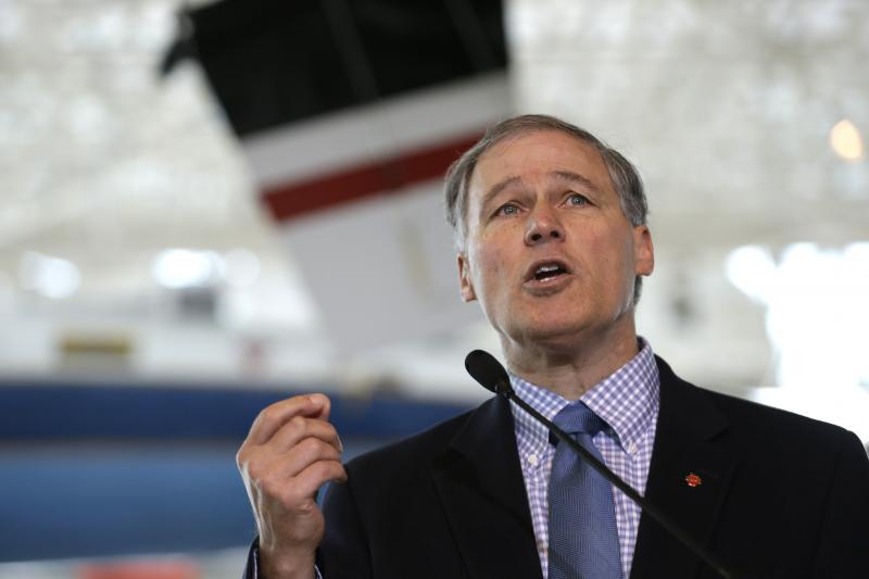 FILE - Gov. Jay Inslee speaks at a signing event for legislation to help keep production of Boeing's new 777X in Washington, Monday, Nov. 11, 2013, at the Museum of Flight in Seattle.