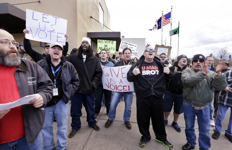 A small group of machinists union members rally in favor of voting on Boeing's last contract offer.