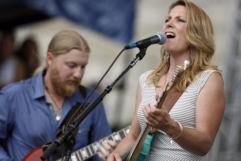 FILE - Susan Tedeschi and Derek Trucks perform with the Tedeschi Trucks Band at the Newport Jazz Festival in Newport, R.I.