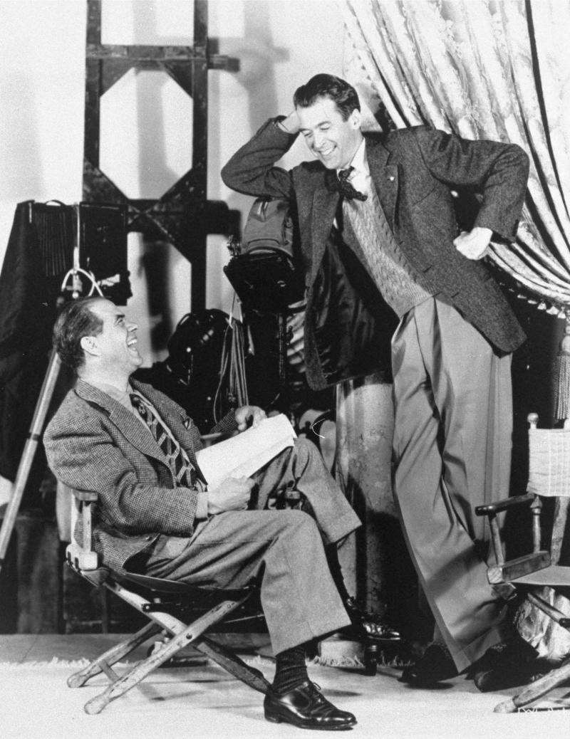 Jimmy Stewart, right, laughs with director Frank Capra in this undated file photo.