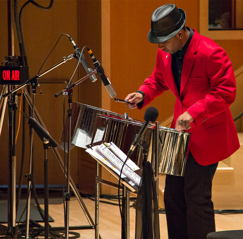 PLU admission counselor, Obe Quarless, plays the steel drums along with the PLU Jazz Ensemble at the 17th Annual KPLU Christmas Jam.