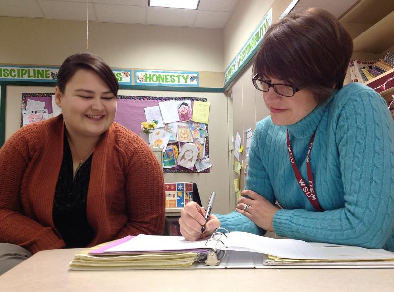 "New teacher Erika McKamey (left) seeks counsel and advice from her teacher mentor Lynn Lofstrom. At this time of year, McKamey is in the ""disillusionment"" stage and is especially stressed out. But she's not ready to quit the profession."