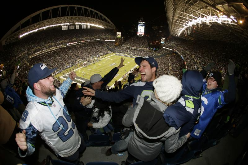 Seahawks fans celebrate after Seahawks' Michael Bennett recovered a New Orleans Saints fumble and scored a touchdown on Monday, Dec. 2, 2013, in Seattle.