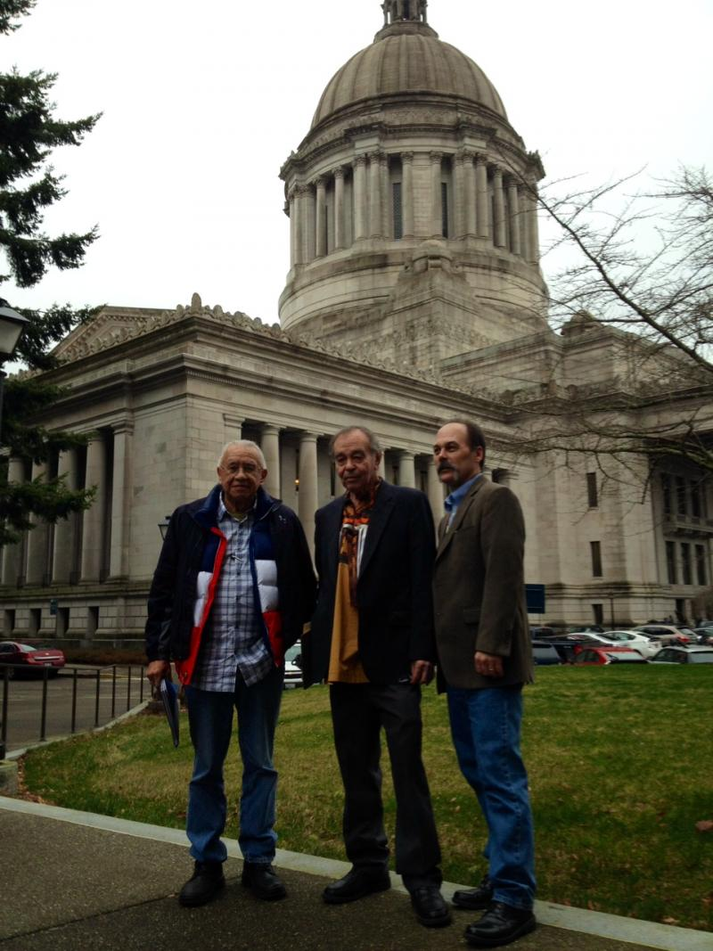 Billy Frank, a veteran of the fish wars, Hank Adams, a tribal advocate, and Shawn Yanity, chairman of the Stillaguamish Tribe confer in Olympia.