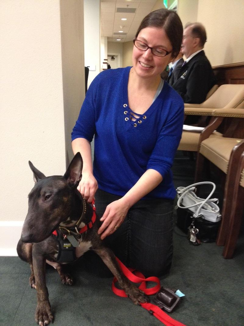 Zak Thatcher and her bull terrier, Ozzy, drove four hours to show their support for breed-neutral legislation.