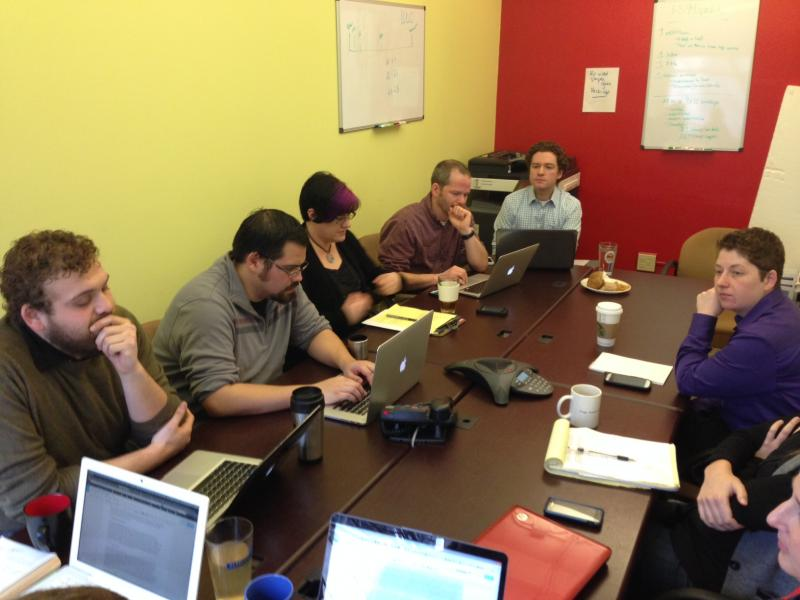 Staff at Fuse Washington meet to update their communications and community organizing efforts.