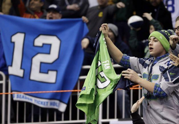 Seattle Seahawks fans cheer during media day for the NFL Super Bowl XLVIII football game Tuesday, Jan. 28, 2014, in Newark, N.J.