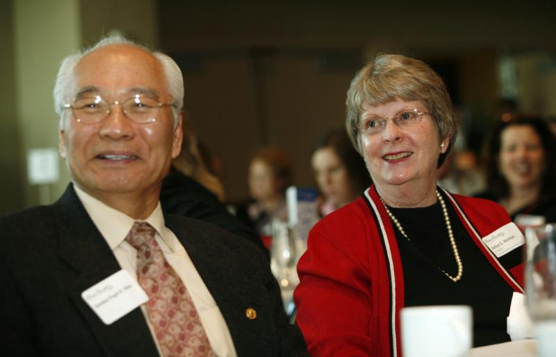 FILE - Jerilyn McIntyre, right, president of Central Washington University, and Sen Paull Shin, D-Mukilteo, listen to speakers during a luncheon that was part of the Higher Education Day in Olympia, Wash., Tuesday, Feb. 20, 2007.