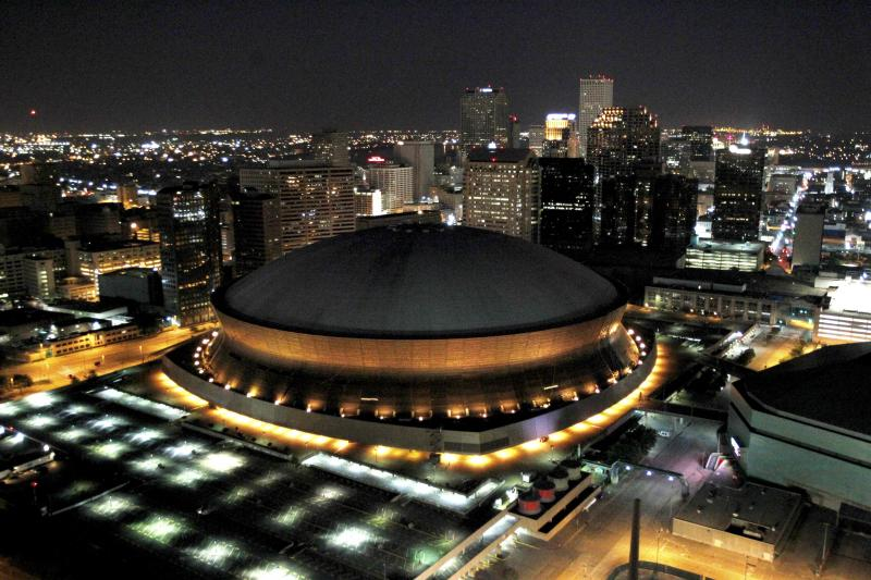 In this July 31, 2010 photo, the Louisiana Superdome and New Orleans skyline are seen from the air at night.