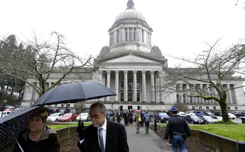 A sidewalk outside the Legislative building is bustling with people on the first day of the 2014 session of the Washington state Legislature, Monday, Jan. 13, 2014, at the Capitol in Olympia, Wash.