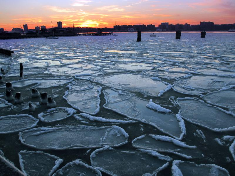 In this Jan. 9, 2014 photo, ice floes cover the surface of the Hudson River off the west side of Midtown Manhattan in New York.