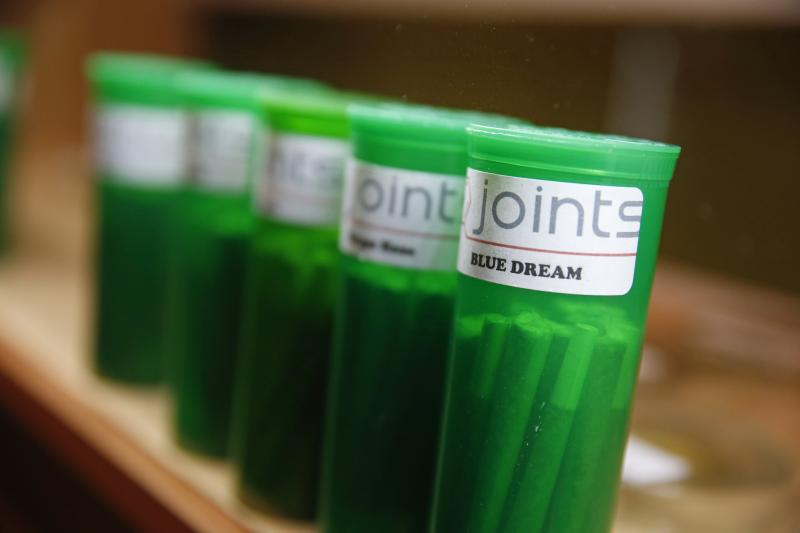In this Dec. 6, 2013 photo, different strains of marijuana are displayed for sale at The Clinic, a Denver-based dispensary with several outlets, in Denver.