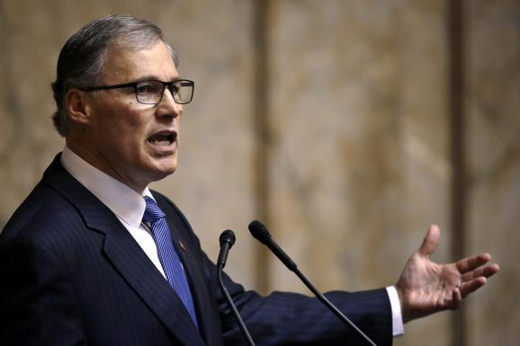 Gov. Jay Inslee speaks during the annual State of the State address to a joint session of the Legisture in the House chambers Tuesday, Jan. 14, 2014, in Olympia, Wash.