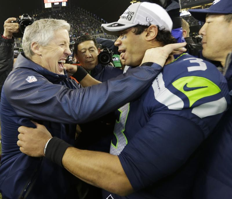 Seattle Seahawks head coach Pete Carroll celebrates with Seattle Seahawks' Russell Wilson after the second half of the NFL football NFC Championship game against the San Francisco 49ers Sunday, Jan. 19, 2014, in Seattle.
