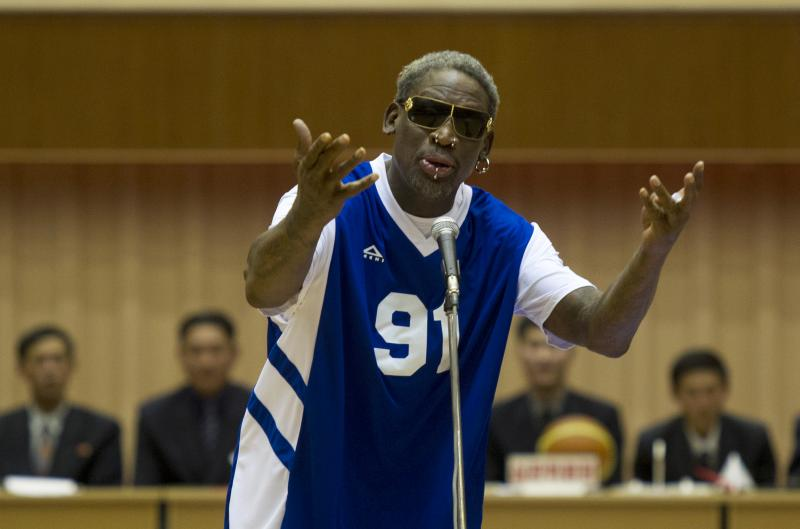 Dennis Rodman sings Happy Birthday to North Korean leader Kim Jong Un, seated above in the stands, before an exhibition basketball game at an indoor stadium in Pyongyang, North Korea on Wednesday, Jan. 8, 2014.