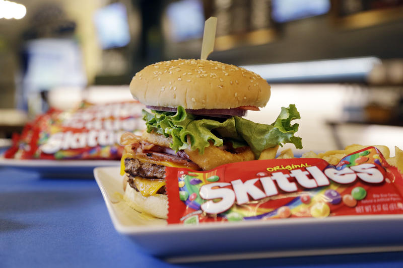 "A ""Beast Burger"" that debuted earlier, in honor of running back Marshawn Lynch, is shown at an event debuting new Seattle Seahawks' team-themed menu items in a restaurant at the team's stadium Wednesday, Jan. 15, 2014, in Seattle."