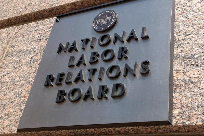 The sign for the National Labor Relations Board is seen on the building that houses their headquarters in downtown Washington, Wednesday, July 17, 2013.