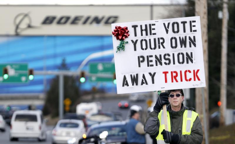 A machinist is seen at a rally against Boeing's latest contract extension offer.