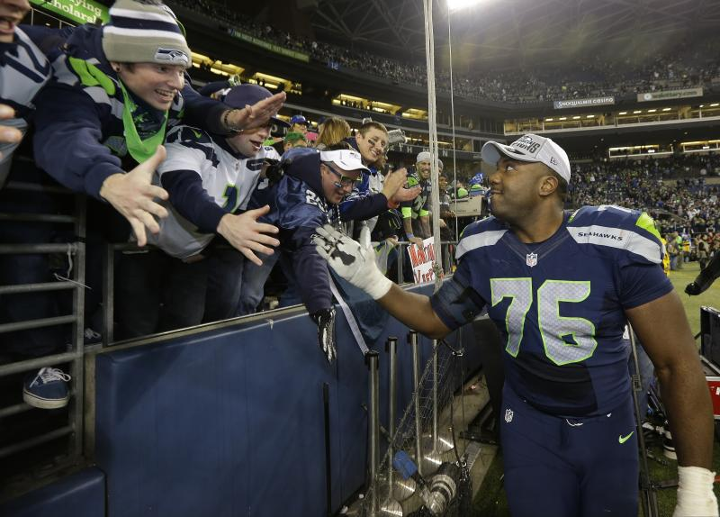 Seattle Seahawks' Russell Okung celebrates with fans after the NFL football NFC Championship game against the San Francisco 49ers Sunday, Jan. 19, 2014, in Seattle.