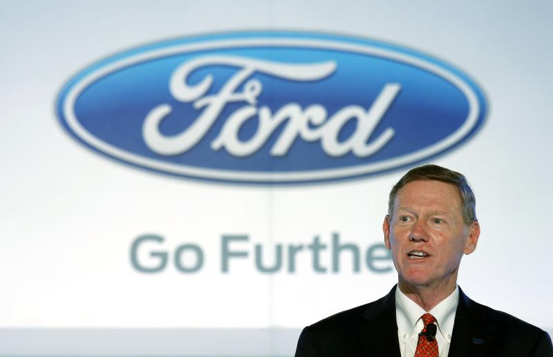 FILE - In this Oct. 21, 2013 file photo, Alan Mulally, president and CEO of Ford Motor Company speaks during a news conference in Hong Kong.