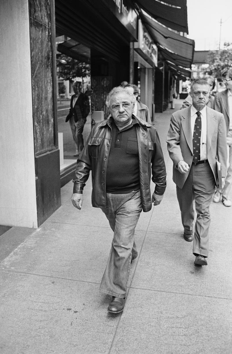 FILE - Frank Colacurcio, left, walks through downtown Seattle with his attorney Bill Helsell on Wednesday, July 9, 1980.